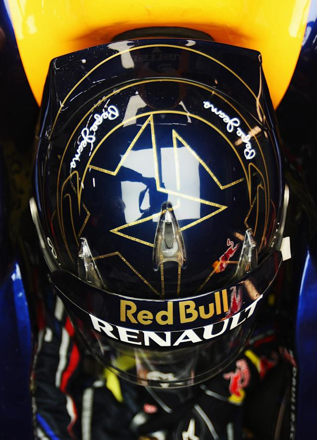 YEONGAM-GUN, SOUTH KOREA - OCTOBER 14: Sebastian Vettel of Germany and Red Bull Racing wears a specially designed drivers helmet featuring two stars to signify his back to back F1 World Drivers Championship titles during practice for the Korean Formula One Grand Prix at the Korea International Circuit on October 14, 2011 in Yeongam-gun, South Korea. (Photo by Mark Thompson/Getty Images)