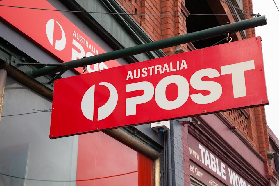 Melbourne, Australia - December 7, 2014: Australia Post is the national supplier of postal services in Australia. This is the Australia Post sign hanging outside a street front store in Hawthorn, Melbourne, Australia.