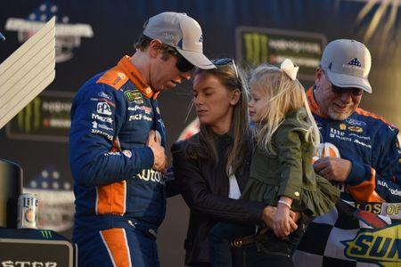 Feb 24, 2019; Hampton, GA, USA; Monster Energy NASCAR Cup Series driver Brad Keselowski (2) talks with his wife Paige White and daughter Scarlett Keselowski after winning the Folds of Honor QuickTrip 500 at Atlanta Motor Speedway. Mandatory Credit: Adam Hagy-USA TODAY Sports