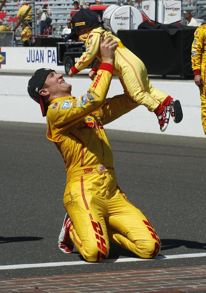 Ryan Hunter-Reay lifts his son, Ryden, after Hunter-Reay won the 98th running of the Indianapolis 500 IndyCar auto race at the Indianapolis Motor Speedway in Indianapolis, Sunday, May 25, 2014. (AP Photo/Tom Strattman)