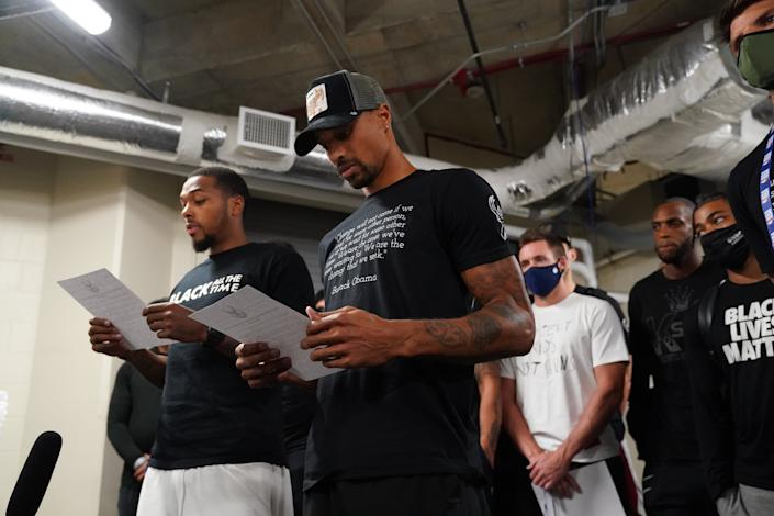 ORLANDO, FL - AUGUST 26: Sterling Brown and George Hill of the Milwaukee Bucks reads a statement to the media on August 26, 2020 at AdventHealth Arena at ESPN Wide World of Sports Complex in Orlando, Florida. (Photo by Jesse D. Garrabrant/NBAE via Getty Images)