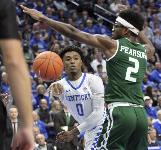Kentucky's Ashton Hagans (0) passes the ball away from UAB's Tamell Pearson (2) during the first half of an NCAA college basketball game in Lexington, Ky., Friday, Nov. 29, 2019. (AP Photo/James Crisp)