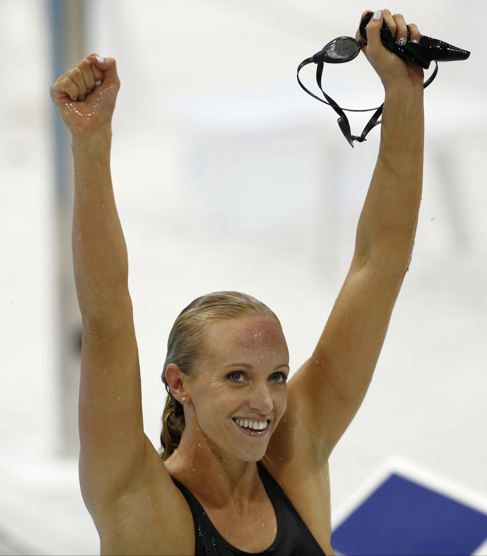 United States' Dana Vollmer celebrates after her gold medal win in the women's 100-meter butterfly swimming final at the Aquatics Centre in the Olympic Park during the 2012 Summer Olympics in London, Sunday, July 29, 2012. (AP Photo/Daniel Ochoa De Olza)