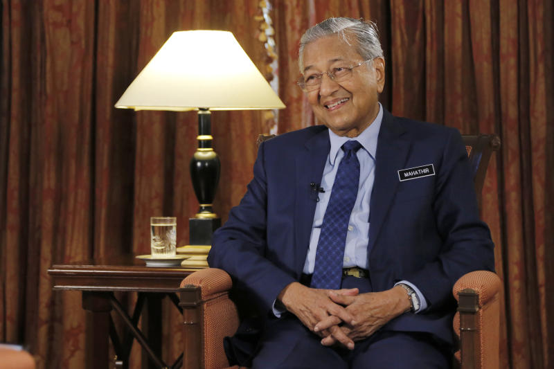 """Malaysia's Prime Minister Mahathir Mohamad is interviewed in Putrajaya, Malaysia, Monday, Aug. 13, 2018. Mahathir said he will seek to cancel multibillion-dollar Chinese-backed infrastructure projects that were signed by his predecessor as his government works to dig itself out of debt, and he blasted Myanmar's treatment of its Rohingya minority as """"grossly unjust.""""  (AP Photo/Yam G-Jun)"""