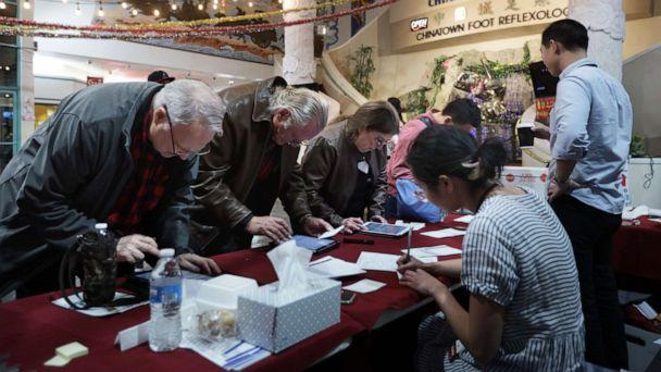 PHOTO: Poll workers check voters in during early voting in the Nevada Caucus at Chinatown Plaza Mall, Feb. 15, 2020, in Las Vegas, Nevada. (Alex Wong/Getty Images)