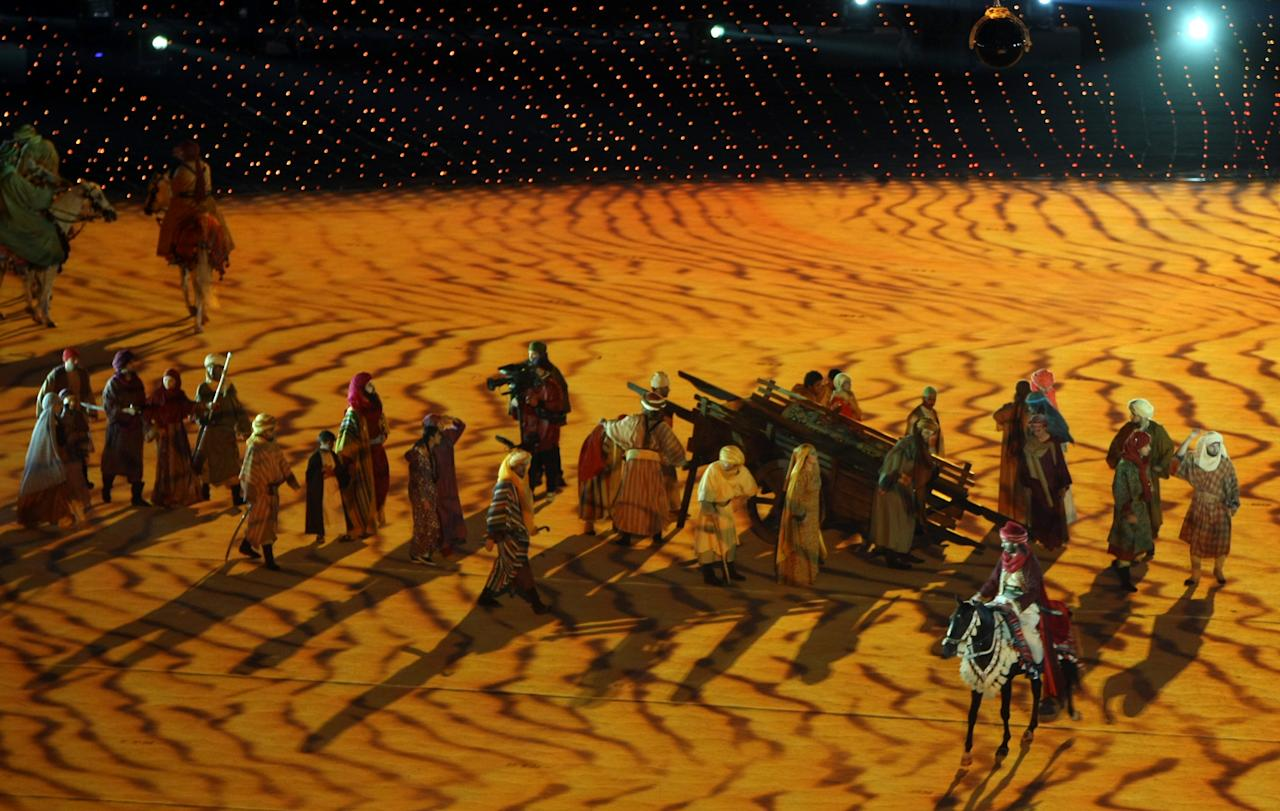 Dancers perform during the opening ceremony of the pan-Arab Games in the Qatari capital Doha on Friday Dec 9, 2011. More than 5,000 Arab athletes are participating in the Arab games from December 9 to 24. (AP Photo/Osama Faisal)
