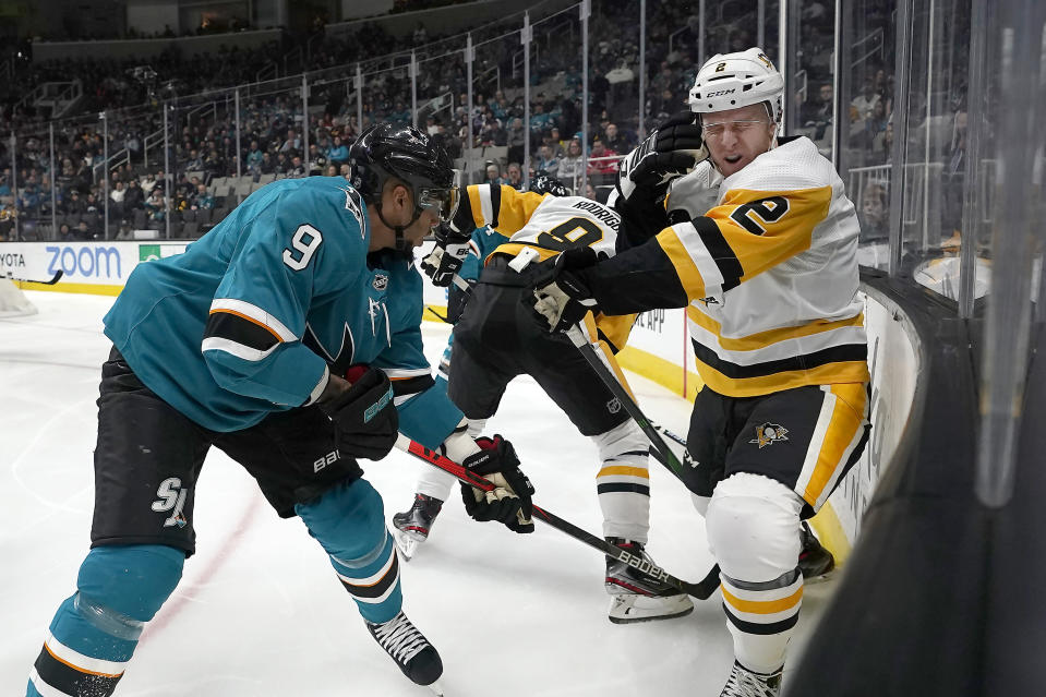 Pittsburgh Penguins defenseman Chad Ruhwedel (2) reacts after a high stick from San Jose Sharks left wing Evander Kane (9) during the second period of an NHL hockey game Saturday, Feb. 29, 2020, in San Jose, Calif. (AP Photo/Tony Avelar)