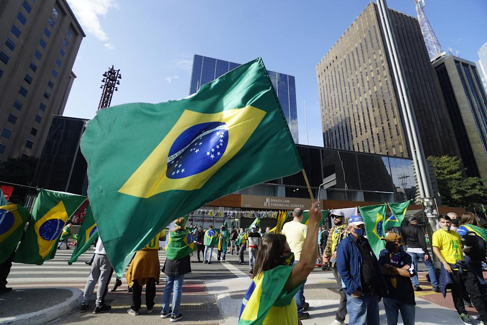 SAO PAULO, BRAZIL - AUGUST 01: Demonstrators take part in a rally in support of Brazilian President Jair Bolsonaro and calling for a printed vote model at Paulista Avenue in Sao Paulo, Brazil on August 1, 2021. - Thousands of Brazilians took to the streets Sunday to support far-right President Jair Bolsonaro in protest against the country's electronic voting system (Photo by Cristina Szucinski/Anadolu Agency via Getty Images)