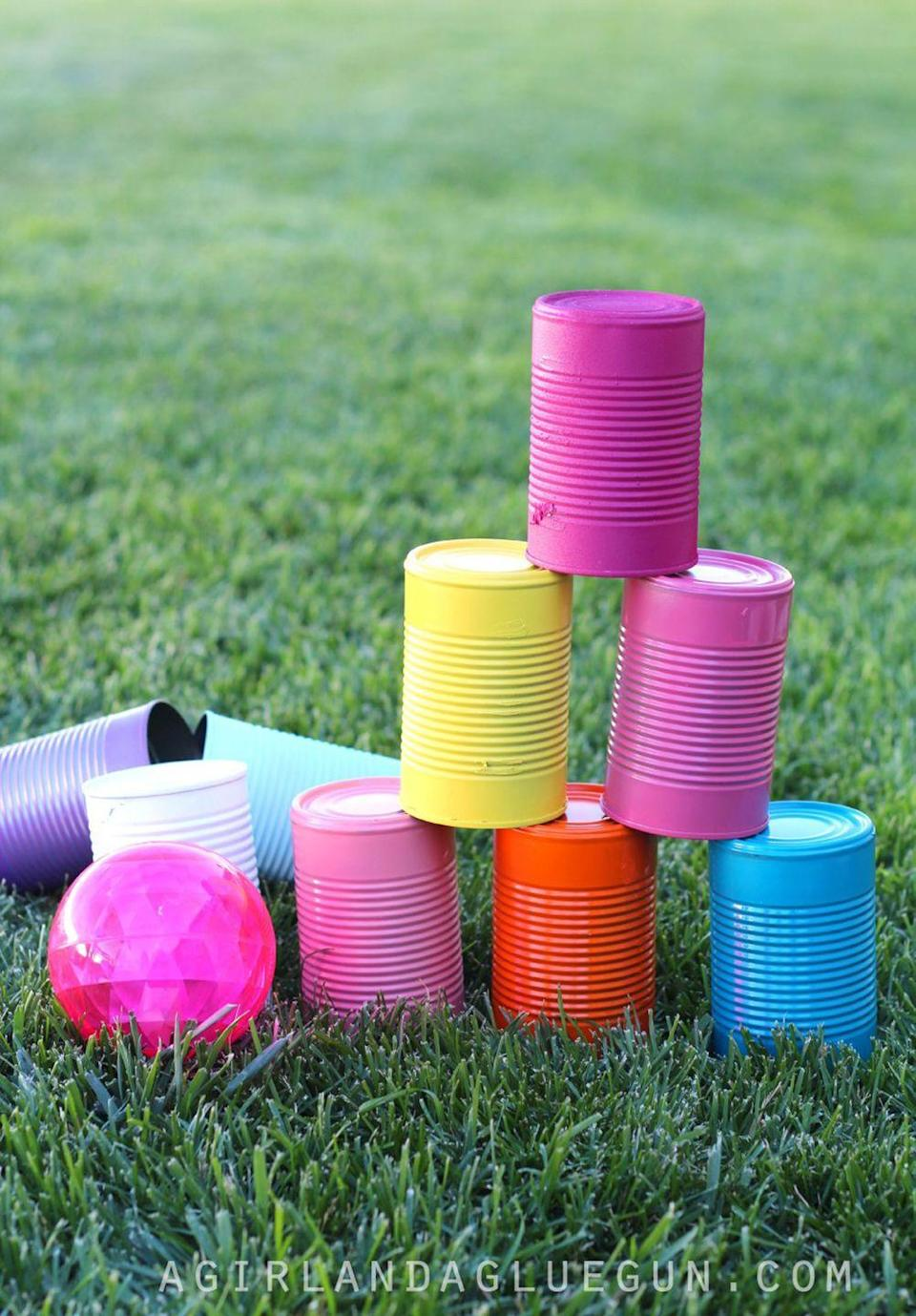 """<p>Reuse soup cans to make this DIY bowling game. Bonus: Ask your kids to help with decorating. </p><p><strong>Get the tutorial at <a href=""""http://www.agirlandagluegun.com/2016/06/5-fun-things-to-do-with-tin-cans.html"""" rel=""""nofollow noopener"""" target=""""_blank"""" data-ylk=""""slk:A Girl and a Glue Gun"""" class=""""link rapid-noclick-resp"""">A Girl and a Glue Gun</a>.</strong></p><p><strong><a class=""""link rapid-noclick-resp"""" href=""""https://www.amazon.com/Bluemoona-10-Pcs-BristlesPerfect-Adhesives/dp/B01J0XVWDG?tag=syn-yahoo-20&ascsubtag=%5Bartid%7C10050.g.21095894%5Bsrc%7Cyahoo-us"""" rel=""""nofollow noopener"""" target=""""_blank"""" data-ylk=""""slk:SHOP PAINT BRUSHES"""">SHOP PAINT BRUSHES</a></strong></p>"""