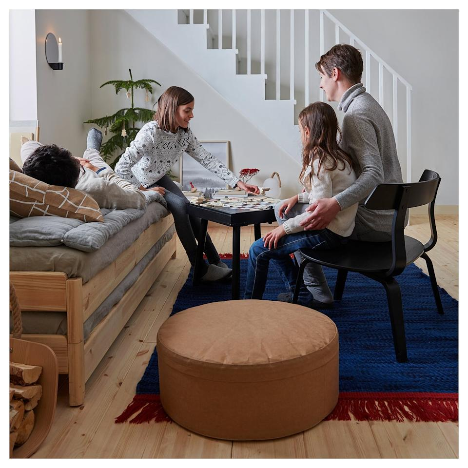 "<p>Not only is the <a href=""https://www.popsugar.com/buy/V%C3%A4rmer-Pouffe-497191?p_name=V%C3%A4rmer%20Pouffe&retailer=ikea.com&pid=497191&price=80&evar1=casa%3Aus&evar9=46708916&evar98=https%3A%2F%2Fwww.popsugar.com%2Fhome%2Fphoto-gallery%2F46708916%2Fimage%2F46708930%2FV%C3%A4rmer-Pouffe&list1=shopping%2Choliday%2Cikea%2Choliday%20decor&prop13=api&pdata=1"" rel=""nofollow"" data-shoppable-link=""1"" target=""_blank"" class=""ga-track"" data-ga-category=""Related"" data-ga-label=""https://www.ikea.com/us/en/p/vaermer-pouffe-paper-light-brown-20440480/"" data-ga-action=""In-Line Links"">Värmer Pouffe </a> ($80) a great additional seat, its cover is removable and machine-washable, in case of a spill. </p>"