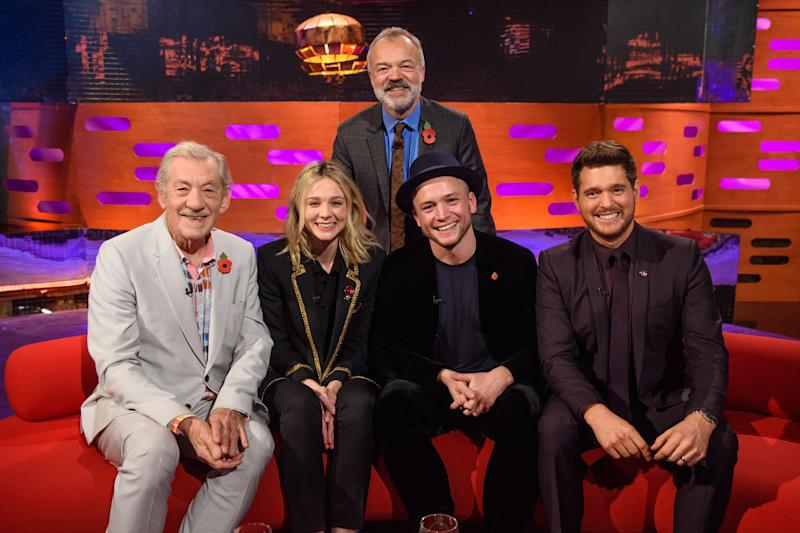Presenter Graham Norton stands behind (left to right) Sir Ian McKellen, Carey Mulligan, Taron Egerton and Michael Buble, during the filming of the Graham Norton Show (Matt Crossick/PA)