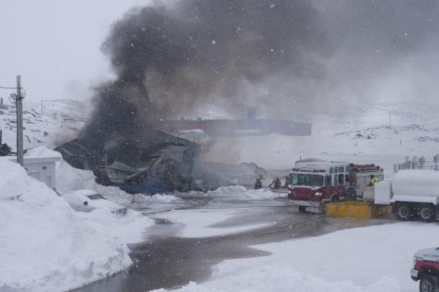 Black smoke rises from the scene of a fire in Iqaluit Monday.