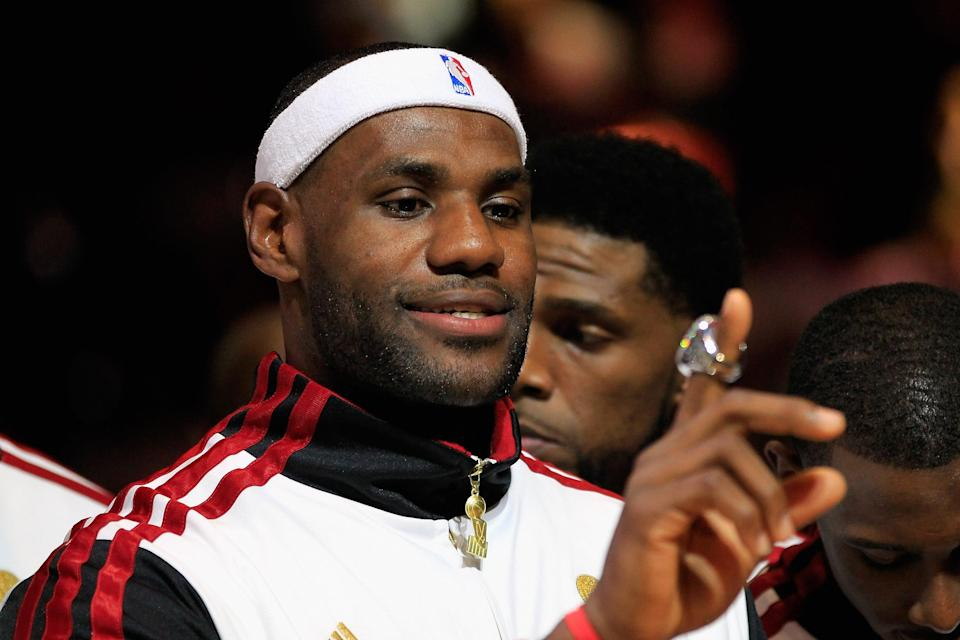 LeBron James #6 of the Miami Heat looks at his 2012 NBA Championship ring following a ceremony prior to the game against the Boston Celtics at American Airlines Arena on October 30, 2012 in Miami, Florida. (Photo by Chris Trotman/Getty Images)
