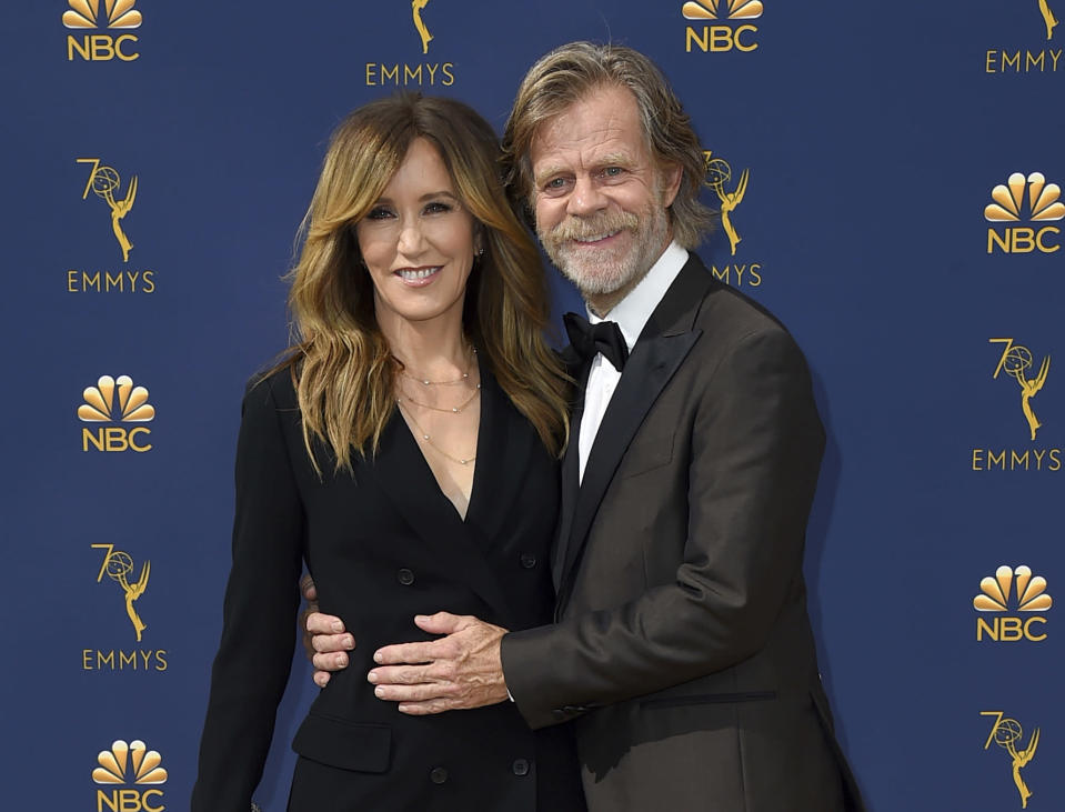 """FILE – In this Sept. 17, 2018 file photo, Felicity Huffman, left, and William H. Macy arrive at the 70th Primetime Emmy Awards in Los Angeles. Huffman and Lori Loughlin were charged along with nearly 50 other people Tuesday, March 12, 2019."""" (Photo by Jordan Strauss/Invision/AP, File)"""