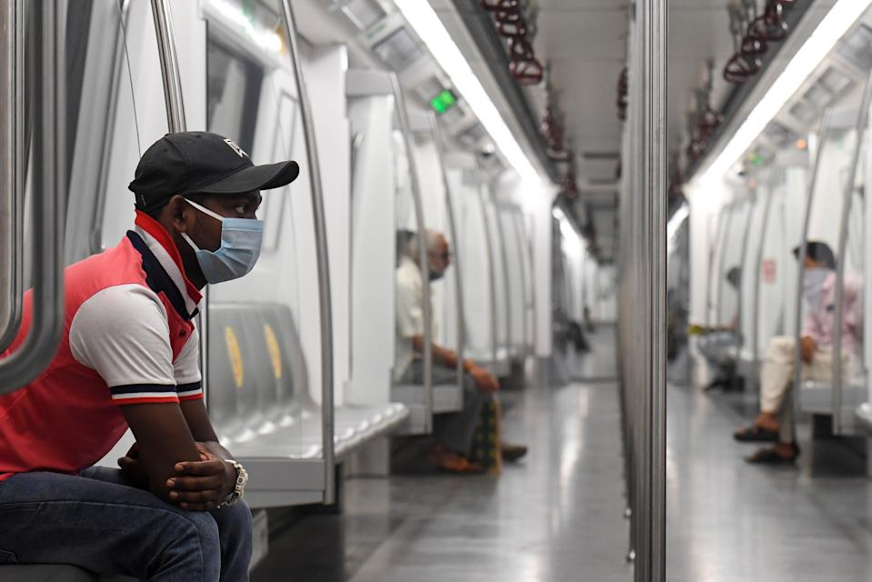 Commuters sit in a carriage of a Yellow Line train after Delhi Metro Rail Corporation (DMRC) resumed services in New Delhi on September 7, 2020.(Photo by PRAKASH SINGH/AFP via Getty Images)
