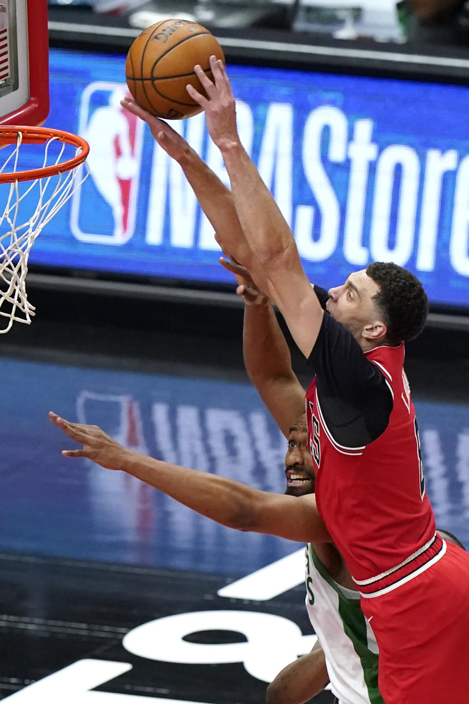 Chicago Bulls guard Zach LaVine, right, shoots against Boston Celtics forward Jabari Parker during the first half of an NBA basketball game in Chicago, Friday, May 7, 2021. (AP Photo/Nam Y. Huh)