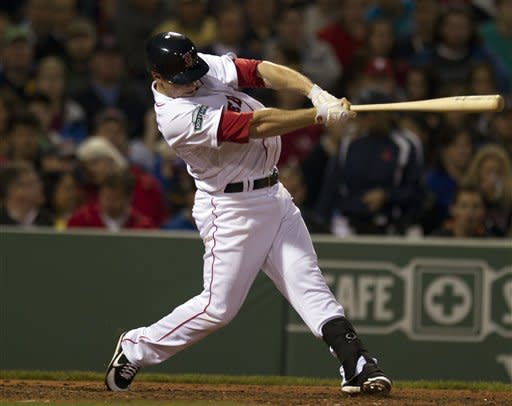 Boston Red Sox's Daniel Nava hits a two-run home run off a pitch by Seattle Mariners' Jason Vargas in the fourth inning of a Major League baseball game at Fenway Park, in Boston, Monday, May 14, 2012. (AP Photo/Steven Senne)