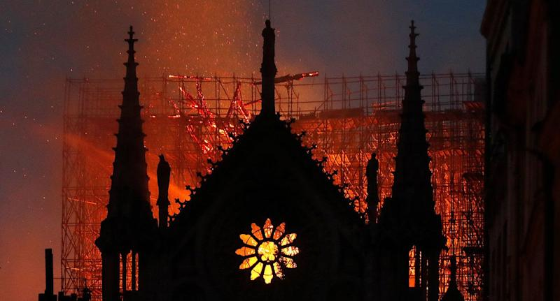 Flames and smoke rise from Notre Dame cathedral as it burns in Paris Monday. (Photo: Thibault Camus/AP)