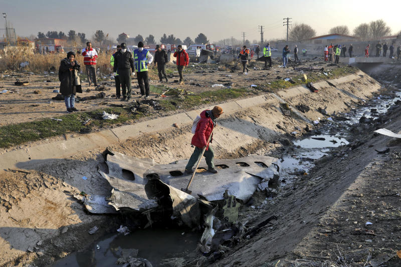 Rescue workers inspect the scene where a Ukrainian plane crashed in Shahedshahr, southwest of the capital Tehran, Iran, Wednesday, Jan. 8, 2020. (Photo: Ebrahim Noroozi/AP)