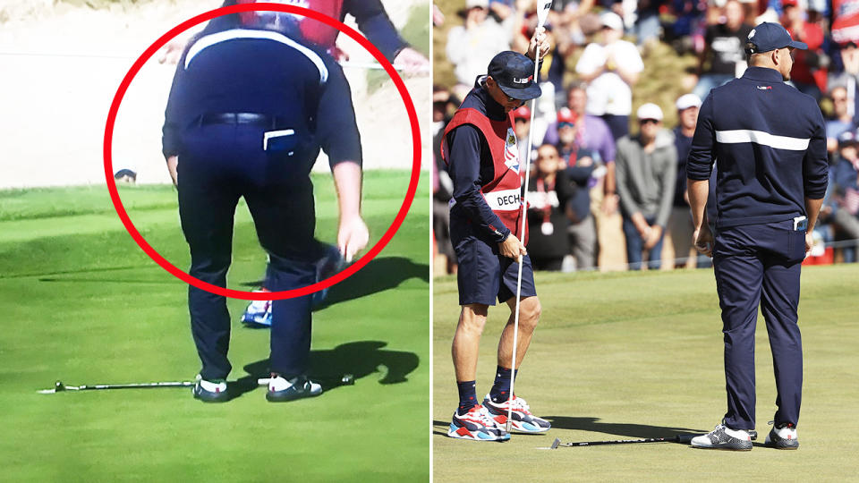 Bryson DeChambeau, pictured here laying down his putter before staring at the Europeans.
