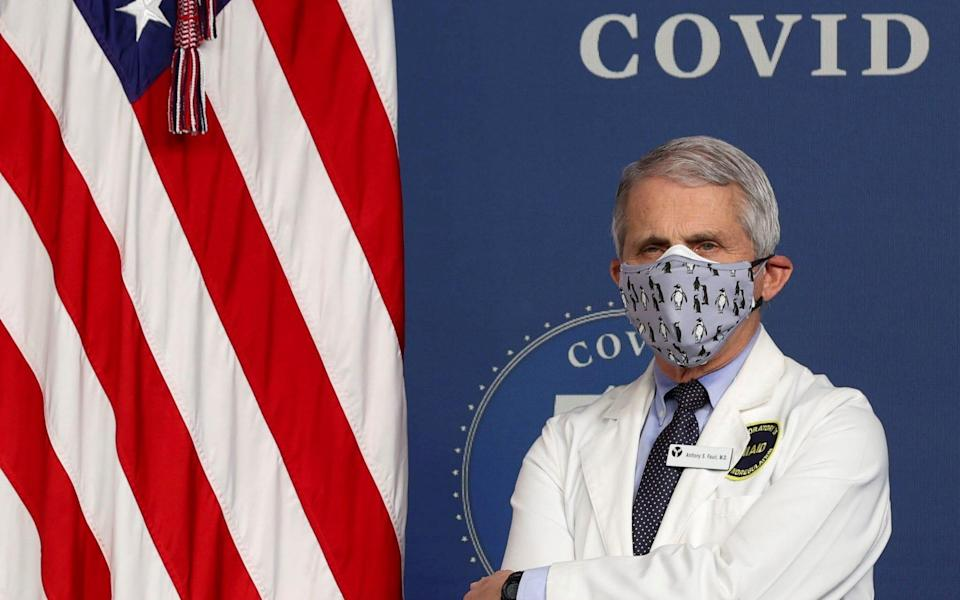 FILE PHOTO: National Institute of Allergy and Infectious Diseases Director Dr. Anthony Fauci stands by during an event to commemorate the 50 millionth coronavirus disease (COVID-19) vaccination in the South Court Auditorium at the White House in Washington, U.S., February 25, 2021. REUTERS/Jonathan Ernst
