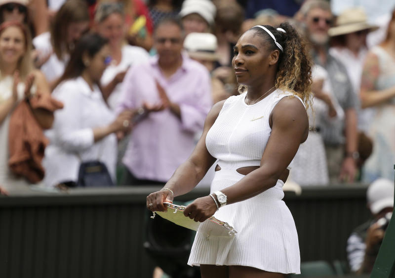United States' Serena Williams holds her second place trophy after losing to Romania's Simona Halep in the women's singles final match on day twelve of the Wimbledon Tennis Championships in London, Saturday, July 13, 2019. Halep defected Williams 6-2/6-2. (AP Photo/Tim Ireland)