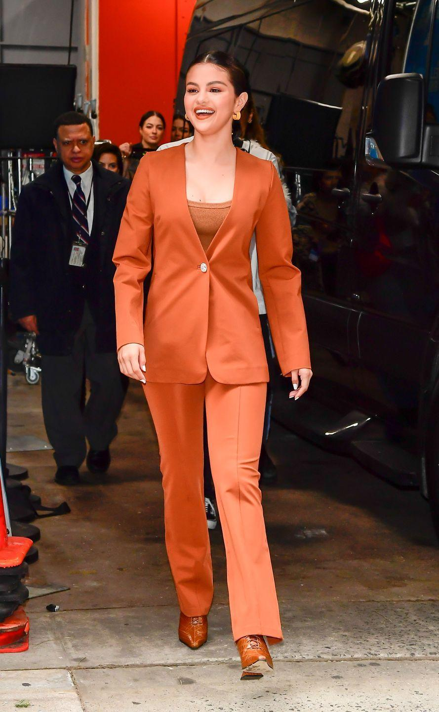 <p>Walking outside of <em>Live with Kelly and Ryan </em>in a burnt orange ensemble. <br></p>
