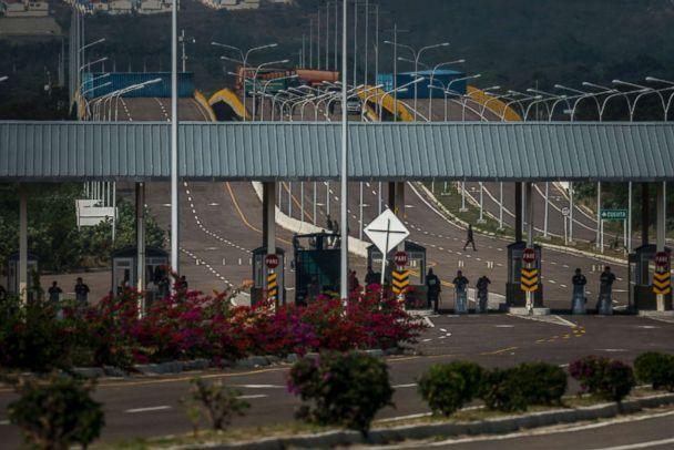 PHOTO: Venezuelan soldiers and shipping containers block the bridge leading to Cucuta, Colombia, Feb. 12, 2019. (Meridith Kohut/The New York Times via Redux)