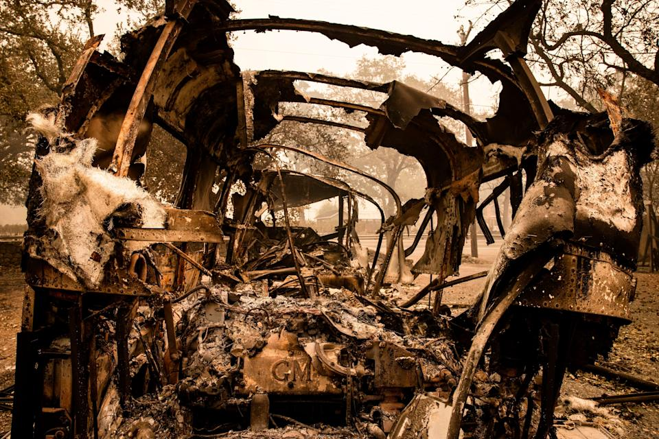 A destroyed vehicle sits outside a Calistoga home on Wednesday.