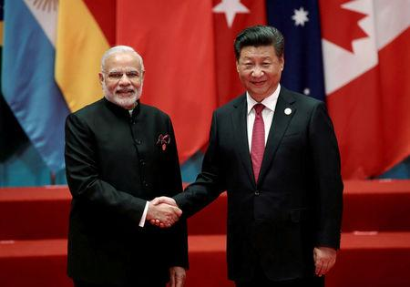 Chinese President Xi Jinping shakes hands with Indian Prime Minister Narendra Modi during the G20 Summit in Hangzhou, Zhejiang province, China September 4, 2016. REUTERS/Damir Sagolj/File Photo