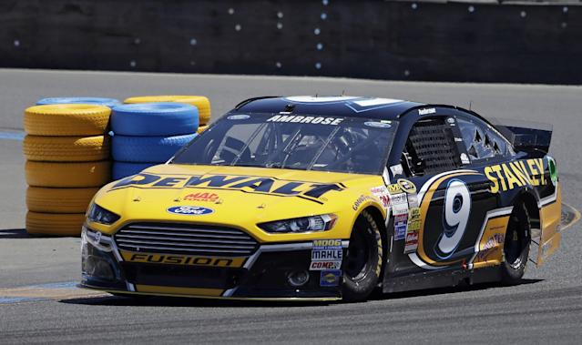 Marcos Ambrose races during practice for the NASCAR Sprint Cup Series auto race Friday, June 20, 2014, in Sonoma, Calif. Ambrose wants nothing more than to break Hendrick Motorsports' four-race winning streak. His best shot comes Sunday on the road course at Sonoma Raceway, where a win could earn the Australian his first berth in the Chase for the Sprint Cup championship. (AP Photo/Eric Risberg)