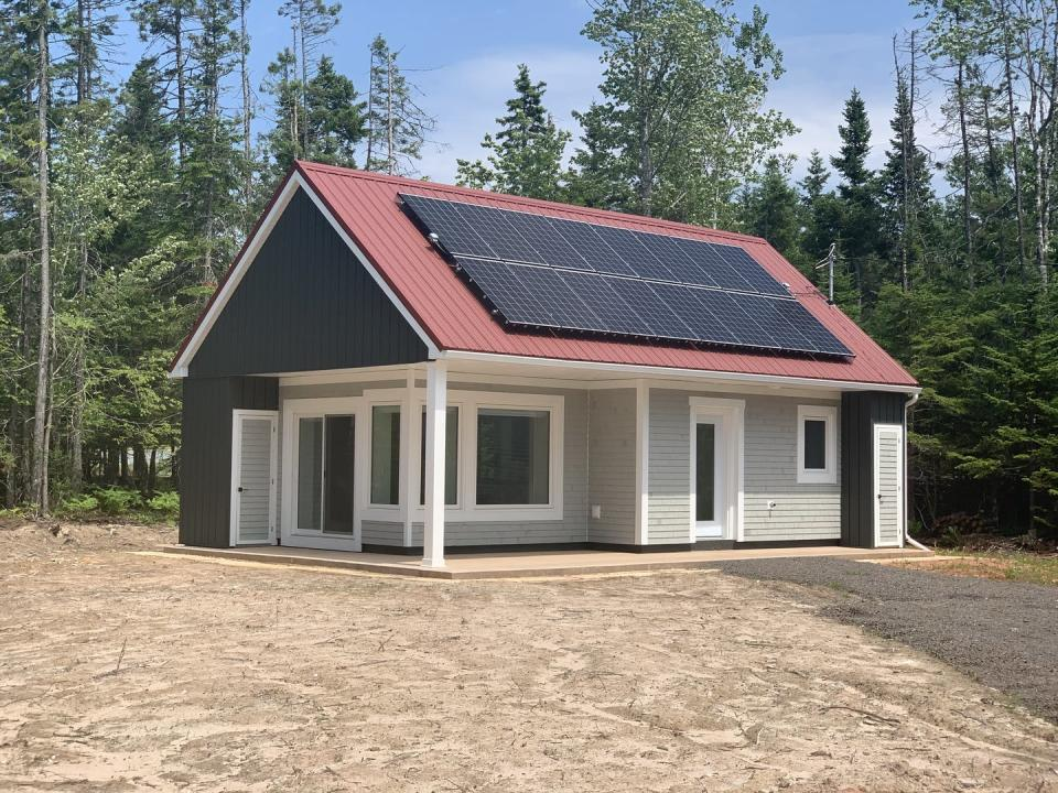 A newly constructed passive home with solar panels on the roof