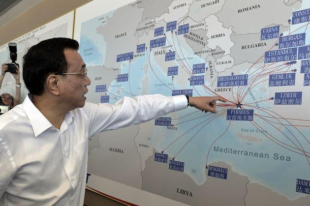 Chinese Prime Minister Li Keqiang looks at a shipping routes map at the port of Piraeus, where Chinese shipping giant Cosco controls two of the three container terminals, on June 20, 2014. Li is in Greece on a three day official visit during which both sides are expected to sign bilateral agreements. AFP PHOTO / POOL /LOUISA GOULIAMAKI        (Photo credit should read LOUISA GOULIAMAKI/AFP via Getty Images) (Photo: LOUISA GOULIAMAKI via Getty Images)