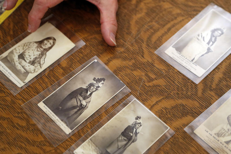 In this Thursday, Nov. 14, 2019 photo, University of Michigan William Clements Library Curator of Graphics, Clayton Lewis, shows examples of cartes de visite from the photographic collection acquired by the library in 2016 from Richard Pohrt Jr. in Ann Arbor, Mich. The trove, representing some 80 indigenous groups, includes photos from government-sponsored expeditions, stereographic and cartes de visites. (AP Photo/Carlos Osorio)