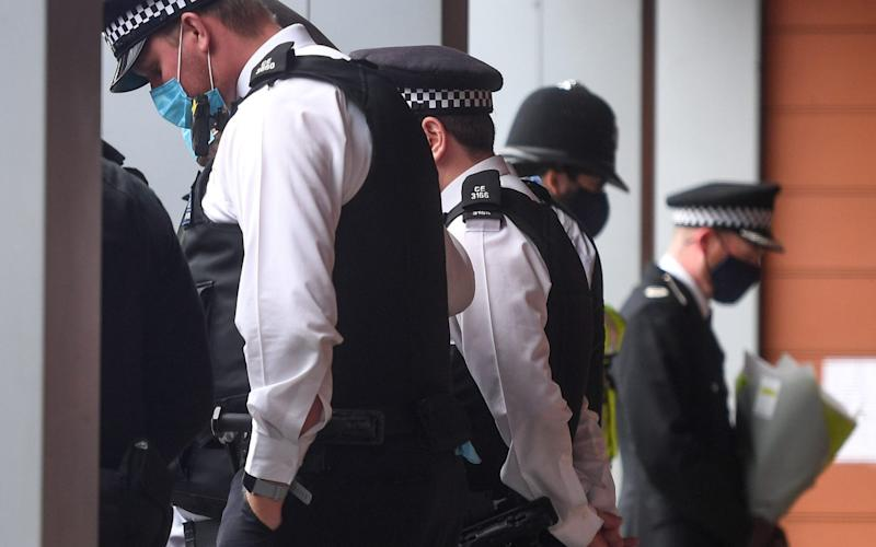 Police officers leave tributes to Sergeant Matiu Ratana outside Croydon Custody Centre on September 27, 2020 in Croydon, England - Peter Summers/Getty Images