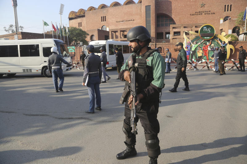 An armed guard stands alert outside the Gaddafi Stadium, Wednesday, Jan. 22, 2020. The three-match Twenty20 cricket series between Pakistan and Bangladesh starts from Friday. (AP Photo/K.M. Chaudary)