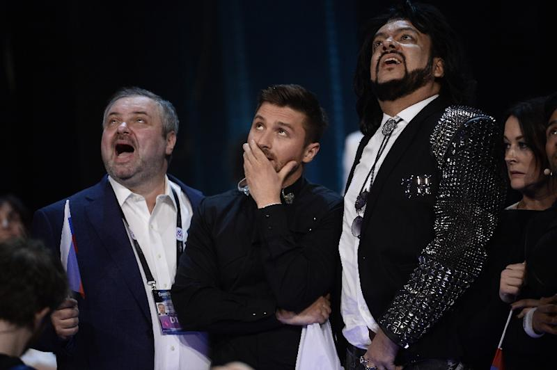 Russia's 2016 entry Sergey Lazarev (C) watches as the final votes count comes in for the Eurovision Song Contest in Stockholm, on May 14, 2016 (AFP Photo/Maja Suslin/TT)