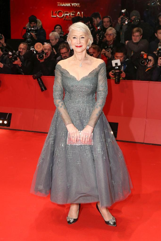 <p>For the premiere of 'Isle of Dogs' in Berlin, Helen Mirren donned a grey-hued cold-shoulder dress by Rami Al Ali and accessorised the look with a pair of bejazzled Jimmy Choo clutch. <em>[Photo: Getty]</em> </p>