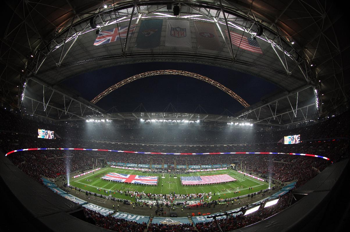 In this image taken with a fish eye lens the British Union flag and the Stars and Stripes are unfurled on the field ahead of the NFL football game between San Francisco 49ers and Jacksonville Jaguars at Wembley Stadium in London, Sunday, Oct. 27, 2013. (AP Photo/Nicky Hayes, NFL UK)