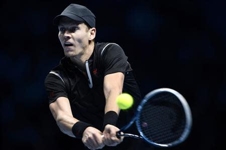 Tomas Berdych of the Czech Republic hits a return to Rafael Nadal of Spain during their men's singles tennis match at the ATP World Tour Finals at the O2 Arena in London November 8, 2013. REUTERS/Dylan Martinez