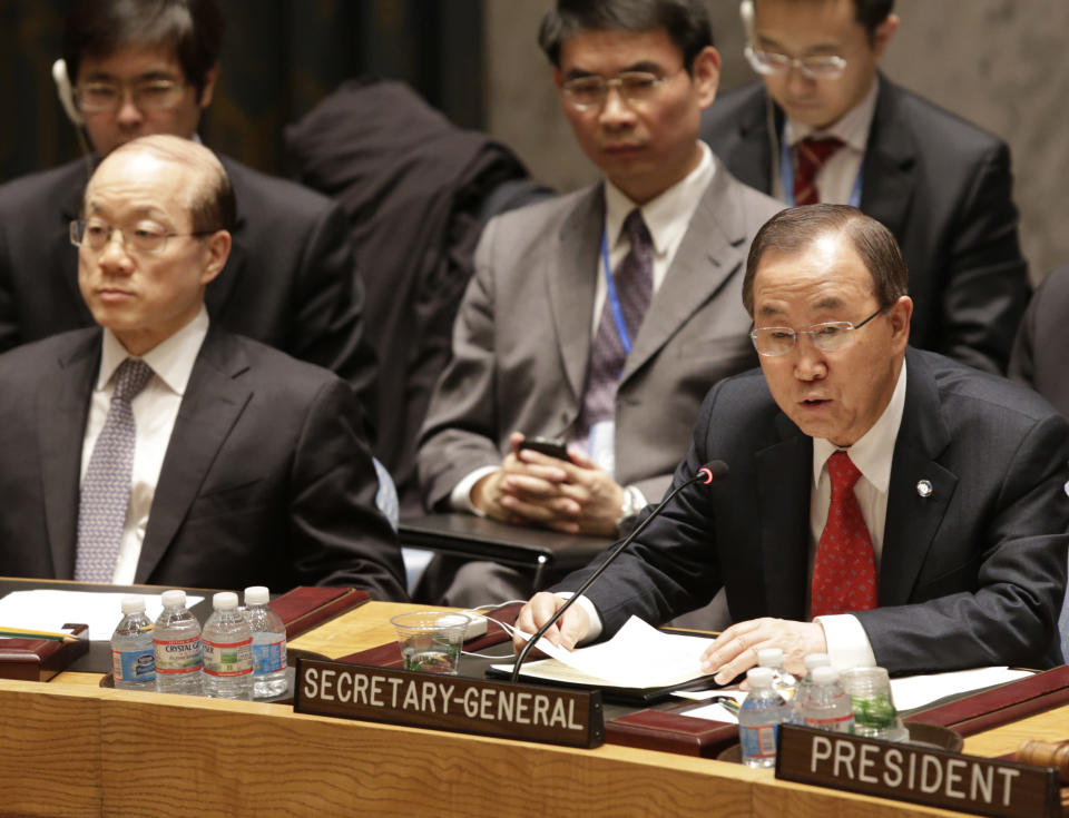 China's U.N. Ambassador Liu Jieyi, left, listens as United Nations Secretary General Ban Ki-moon speaks during a United Nations Security Council meeting at United Nations headquarters, Tuesday, Dec. 24, 2013. The U.N. Security Council voted to temporarily increase the U.N. peacekeeping force in conflict-torn South Sudan to 12,500 troops from 7,000, a nearly 80 percent increase. (AP Photo/Kathy Willens)