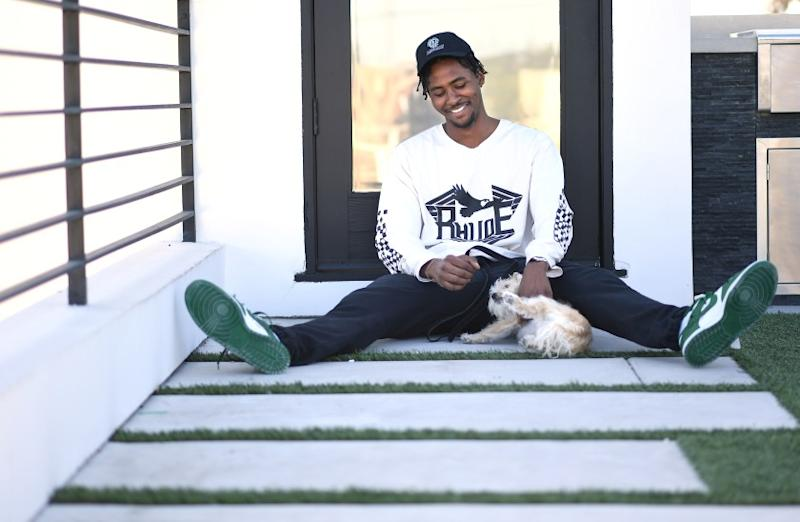 VENICE, CALIFORNIA MAY 21, 2020-NBA player Moe Harkless spends time at home with his dog in Venice as he awaits the restart of the NBA season. (Wally Skalij/Los Angeles Times)