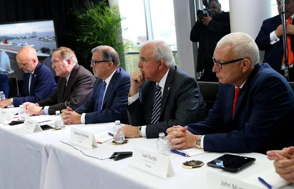 Miami-Dade County Mayor Carlos Gimenez (second from right) and Juan Kuryla (far right) director of PortMiami, joined US. Vice President Mike Pence and Florida Gov. Ron De Santis, during a meeting at Port Everglades with cruise company executives to discuss the coronavirus response on March 7, 2020.