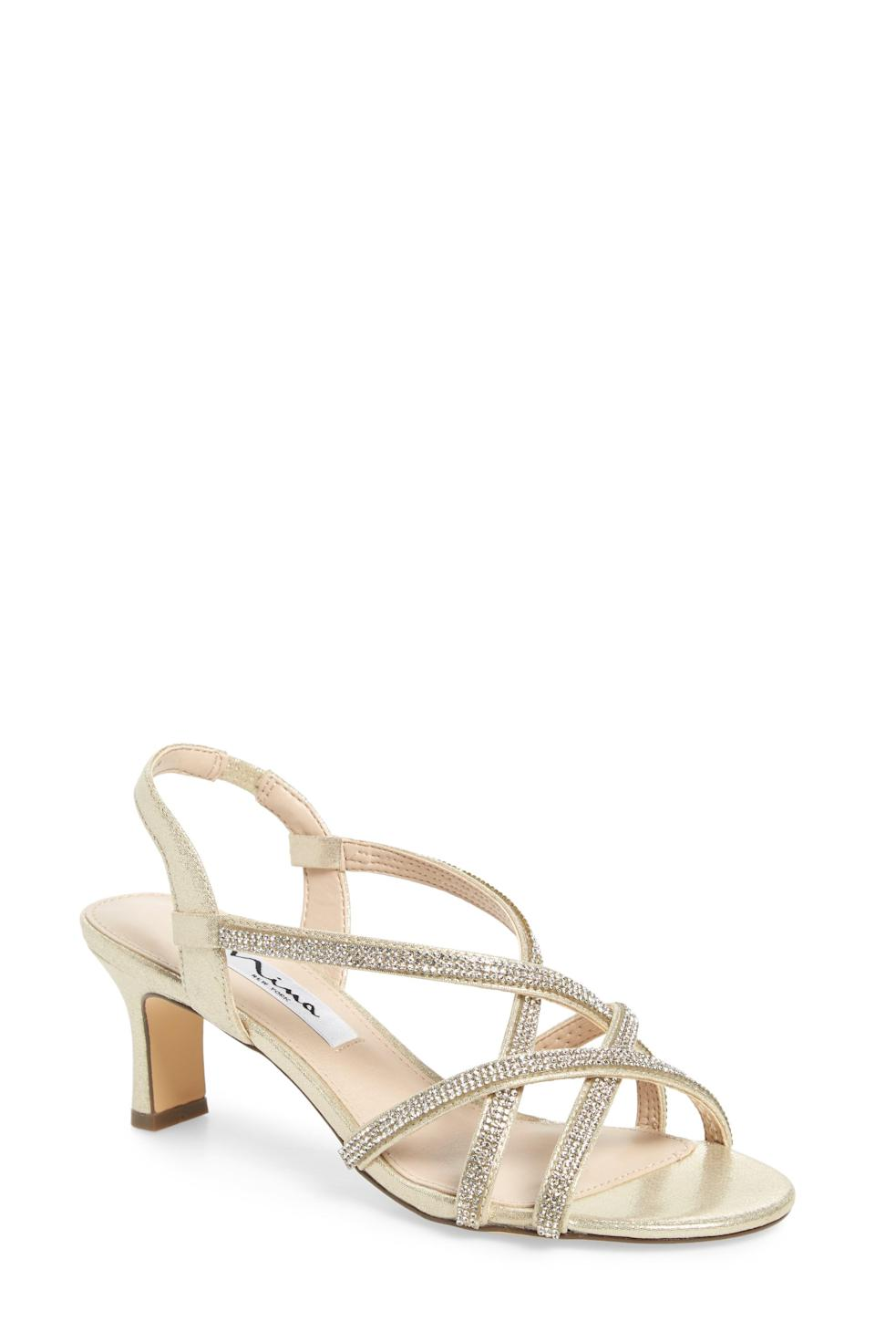 """<p><strong>NINA</strong></p><p>nordstrom.com</p><p><strong>$88.95</strong></p><p><a href=""""https://go.redirectingat.com?id=74968X1596630&url=https%3A%2F%2Fwww.nordstrom.com%2Fs%2Fnina-noni-crystal-embellished-slingback-sandal-women%2F5243791&sref=https%3A%2F%2Fwww.thepioneerwoman.com%2Ffashion-style%2Fg36122557%2Fcomfortable-wedding-shoes%2F"""" rel=""""nofollow noopener"""" target=""""_blank"""" data-ylk=""""slk:Shop Now"""" class=""""link rapid-noclick-resp"""">Shop Now</a></p><p>Dress up with a more classic wedding shoe, embellished with crystals and an easy slingback. The low heel and cushioned footbed will allow you to dance all night.</p>"""