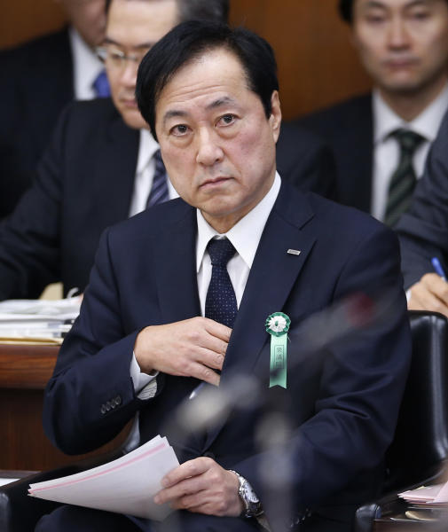 Mizuho Financial Group President Yasuhiro Sato listens to a lawmaker's question as he is summoned by the Committee on Financial Affairs of the lower house of Parliament in Tokyo Wednesday, Nov. 13, 2013. Japanese banks are pledging more stringent efforts to prevent dealings with organized crime after an investigation into such lending at Mizuho prompted disclosures of wider problems. Sato forfeited six months pay, and the chairman of Mihuzo's banking business resigned. Asked if that was penalty enough, Sato acknowledged some people were calling for harsher penalties, but noted that his bank was not the only lender to have been caught extending mob-linked loans. (AP Photo/Shuji Kajiyama)