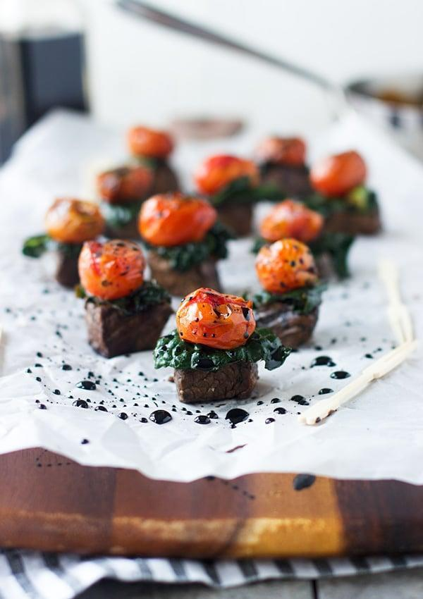 """<p>Wow everyone around the table with these delicious steak bites. They're rich in flavor and taste just as good as a steakhouse's very own recipe. This recipe makes 30 bites, so we suggest cutting the recipe down to make around four to eight if you're just serving two people. </p> <p><strong>Get the recipe:</strong> <a href=""""http://www.cookingforkeeps.com/2015/02/11/balsamic-marinated-steak-bites-kale-roasted-tomatoes/"""" class=""""link rapid-noclick-resp"""" rel=""""nofollow noopener"""" target=""""_blank"""" data-ylk=""""slk:balsamic steak bites with kale and roasted tomatoes"""">balsamic steak bites with kale and roasted tomatoes</a> </p>"""