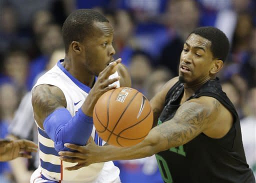 DePaul guard Worrel Clahar, left, passes against Notre Dame guard Eric Atkins during the first half of an NCAA college basketball game in Rosemont, Ill., on Saturday, Feb. 2, 2013. (AP Photo/Nam Y. Huh)