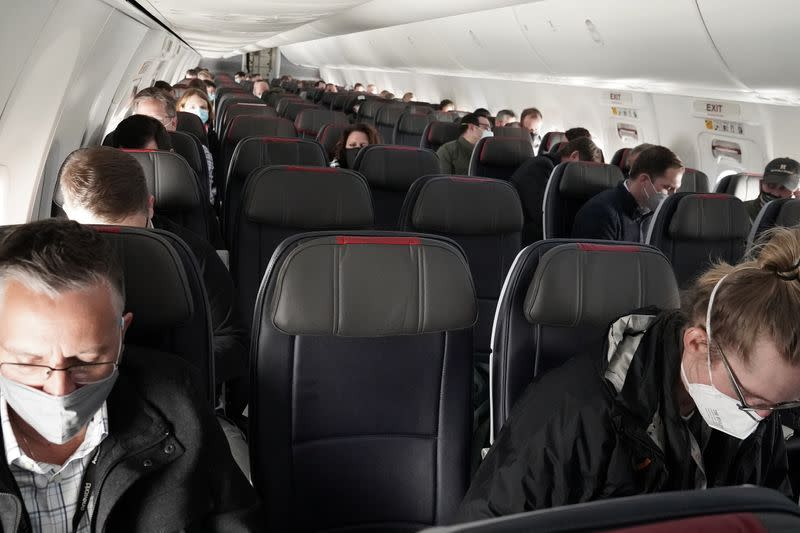 People fly on a media flight aboard a Boeing 737 Max airplane from Dallas Fort Worth Airport to Tulsa