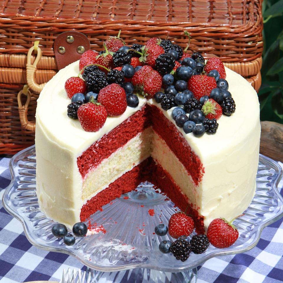 "Three layers of red velvet and lemony white cake, topped with cream cheese icing and a mound of fresh berries just make be the ultimate way to ring in the Fourth. <a href=""https://www.epicurious.com/recipes/food/views/glorious-red-white-and-blue-cake-366289?mbid=synd_yahoo_rss"" rel=""nofollow noopener"" target=""_blank"" data-ylk=""slk:See recipe."" class=""link rapid-noclick-resp"">See recipe.</a>"