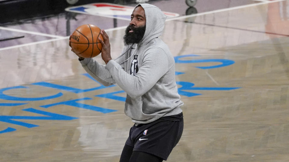 Brooklyn Nets guard James Harden warms up before the start of an NBA basketball game against the Charlotte Hornets, Friday, April 16, 2021, in New York. (AP Photo/Mary Altaffer)
